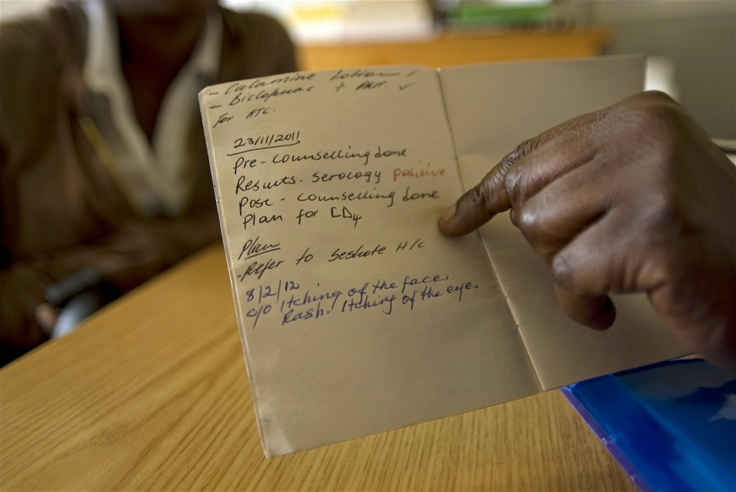 Nurse Mary Joseph Tieala with an HIV-positive patient's record at Semenanyane health clinic in Thaba-Tseka, eastern Lesotho
