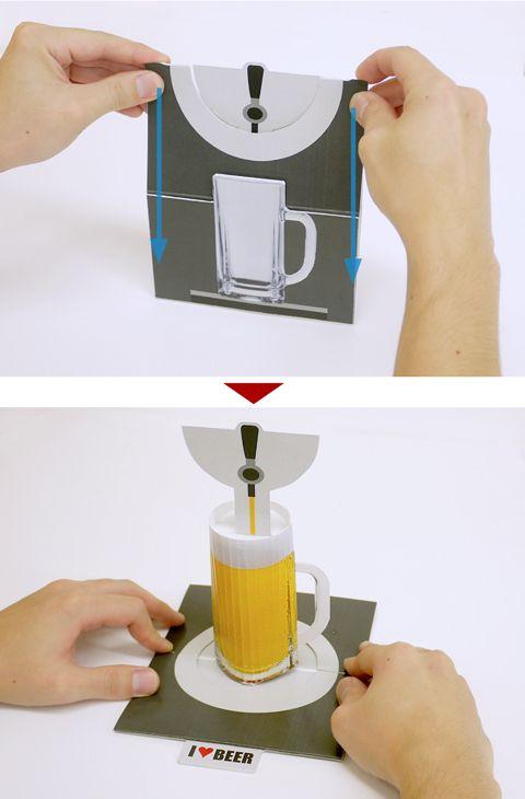 In Japanese, no tut. But, fabulous ingenuity! こんにちは。今週はちょっと変わったポップアップカードのご紹介。まずは展開前。サーバーの前に置かれた冷えたジョッキ。普通の見開きPOPUPではなく台紙を立てて上から押すしくみになっています。どんな飛び出し方をするかというと・・・いかがでしょうか?美味しそうなビールが出現しました。ニョキっと突然現れる様は結構不思議に見えます。あと数時間後、今日もぐいっと飲み干したいですね。...