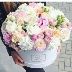 pretty floral arrangement in a large hatbox by Bloom de Fleur