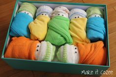 Someone get pregnant, I want to make this!!! Diaper Babies (baby shower gift): newborn diapers, wash cloths, mittens and socks all bundled up into a keepsake box.