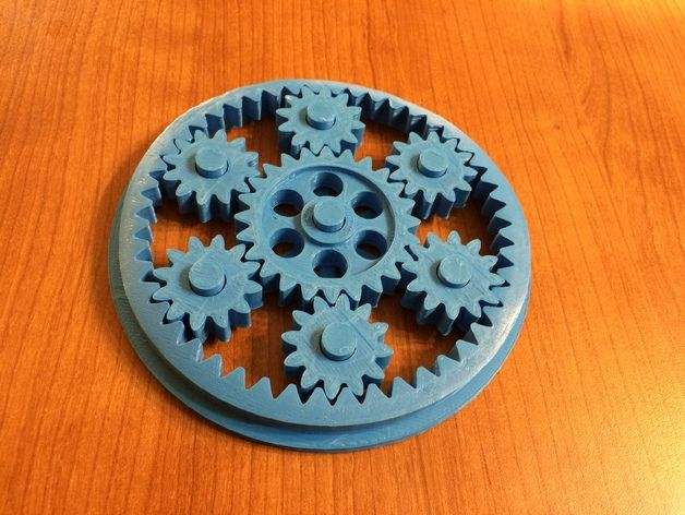 This second gear toy has undergone some evolution and careful revision by yours truly to improve it to the point that you will actually want to take the time to print it!  Allow about one full workday to print it as the outer ring gear and base take a few hours each.  The little gears print quickly by comparison.   I'm sending a physical print of this one in blue (see photo) to my niece Ava - I hope she likes it!