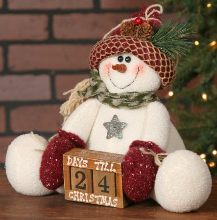 "Primitive Snowman with Calendar with Red Hat - Jolly Snowmen! Each snowman wears black boots, a colorful toboggan hat and scarf! They have embroidered smiles that make them look so happy, they will bring cheer to everyone who sees them on your Christmas tree! 9"" High."