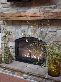 stone veneer fireplace. Love the rough mantle