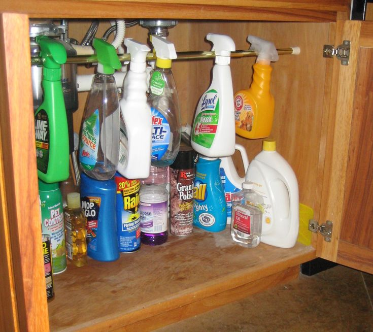 Spray Bottle Space Saver – A great tip using a tension rod under the sink to keep your spray bottles organized and free up space for other cleaning products.