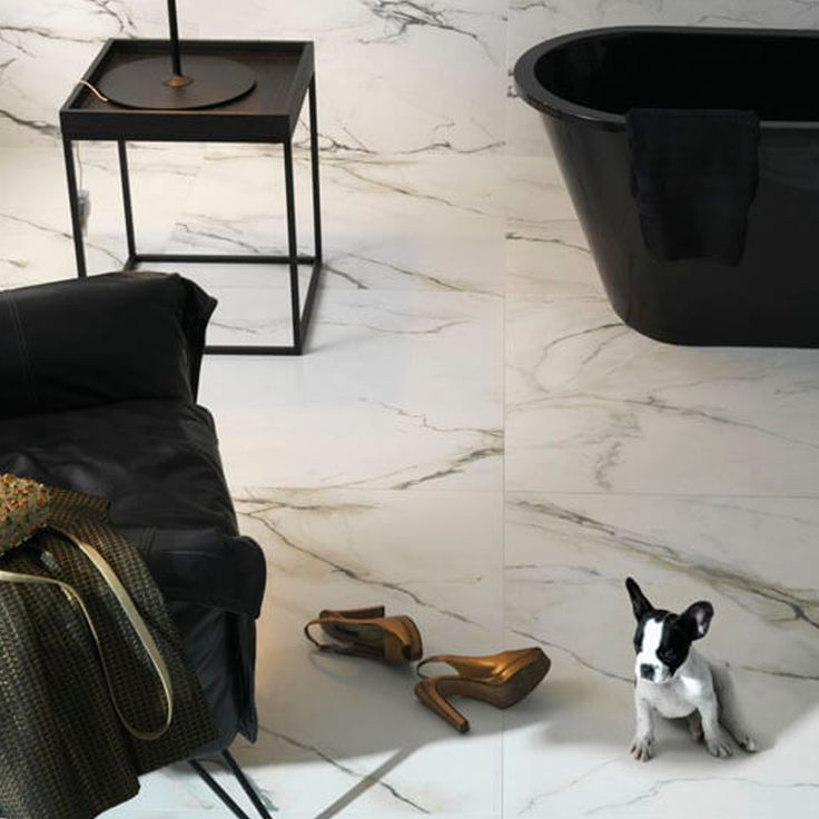 Beautiful marble tiles and a cute frenchie to go with it.  These Carrara marble tiles by Portobello are available to view online now.