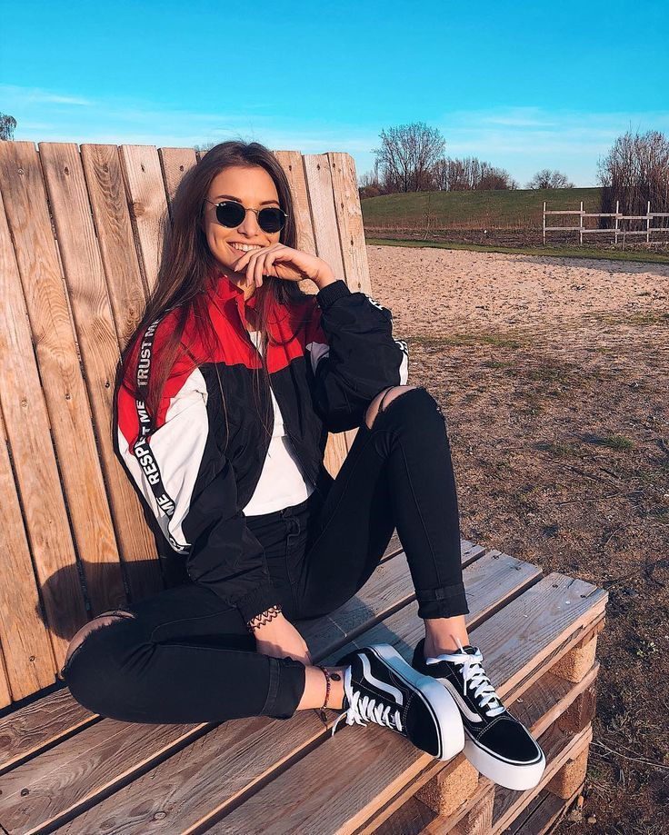 Vans and black, white, and red windbreaker. A classic street style look. A casual fall or winter outfit.