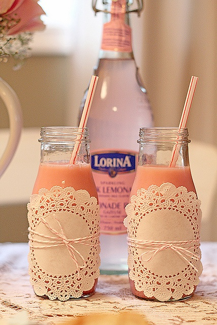 Milk jars!! Appropriate for a baby shower!! Doillies?? w/ twine or raffia bows!