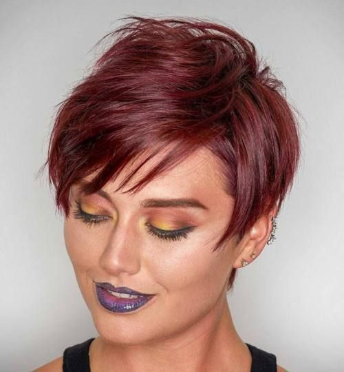 vine red layered pixie - If you're gonna go short, you should go red while you're at it! A bright crimson hair hue is the perfect way to brighten up your pixie cut. Make sure to invest in a color-enhancing hair mask that protects your color and keeps your color-treated strands from getting dry and brittle.