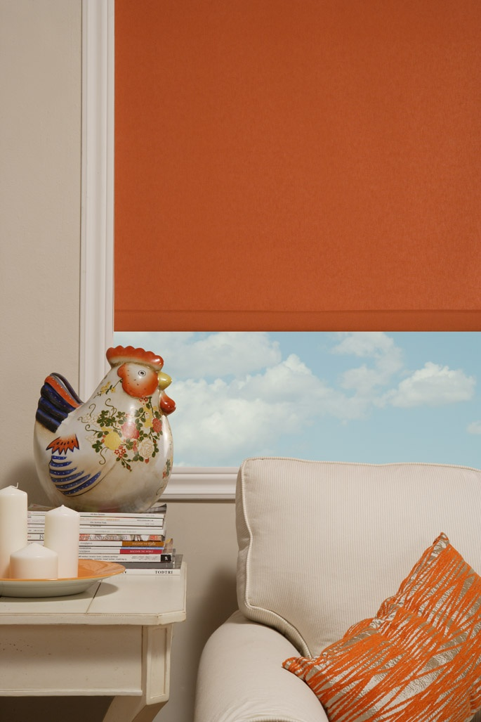 Maxxmar Roller Shade in a vibrant Orange.