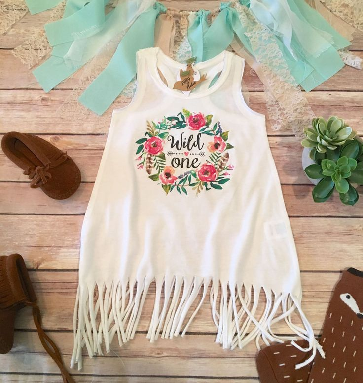 """Boho Baby First Birthday Fringe Tunic/Dress! Hippie Baby Tunic Tank/Dress with adorable watercolor style wreath with flowers and """"Wild One"""" printed inside in black with decorative design and heart sha"""
