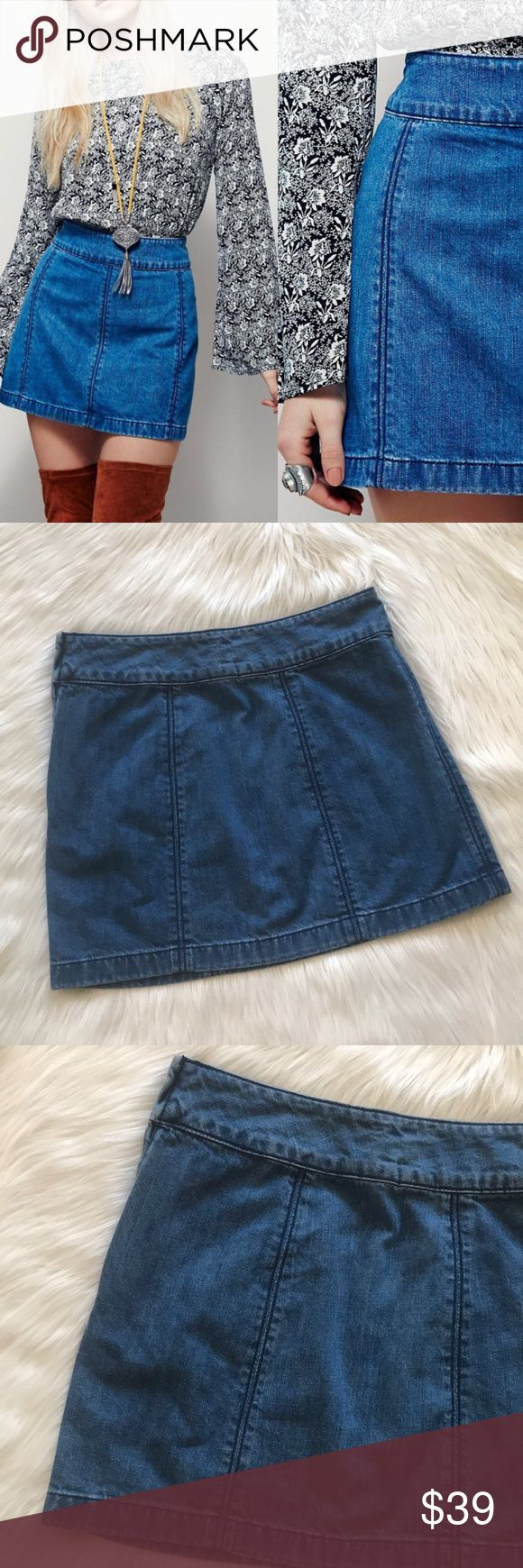 """Free People Denim Zip Up Mini Skirt Jean Skirt The perfect staple piece for your outfit! Medium wash denim with deeper blue seam stitching for added detail and has natural fading at the waistband and hemline. Never worn. Zips up the side. Length is 15.5"""" Free People Skirts Mini"""