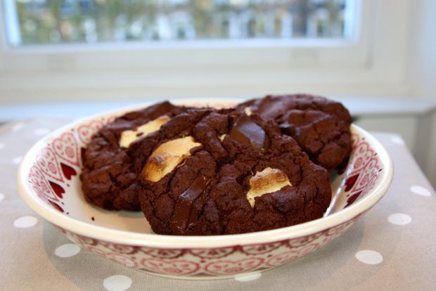 Tanya Burr's Chocolate Cookies (US Conversion): 14 tbsp unsalted butter, 1 1/4 cups super fine sugar, 1 egg, 2 cups self rising flour, 2/3 cup unsweetened coco powder, dash of milk, chocolate of your choice (break up). Preheat oven to 395, cream together butter & sugar, add egg, stir in dry ingredients, add dash of milk if mix is dry, add in chocolate chunks. Line 2 big trays with tin foil, divide mix into 10 cookies (large when finished), bake for 11 min (will not look done), cool for 30…
