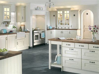 a rustic white kitchen with an elegant charm