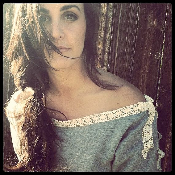 get a regular sweatshirt, cut off collar, make new lace collar... so cute.