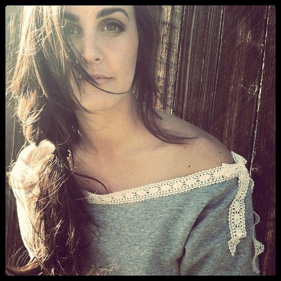 get a regular sweatshirt, cut off collar, make new lace collar