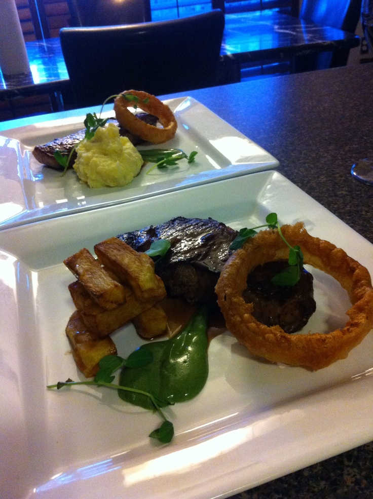 Fun play on a classic. Chicago style NY Strip loin, beefeater fries, creamed spinach, onion ring, black truffle jus. #chef_junpet