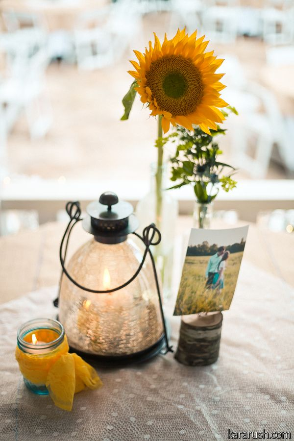 This was a simple centerpiece with a single Sunflower in a bud vase a seperate vase with