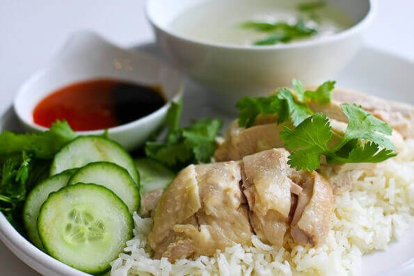 Authentic Hainanese Chicken Rice Recipe with step by step photos to help you perfect this classic Singaporean dish. From cookbook author and TV chef Jaden of Steamy Kitchen.