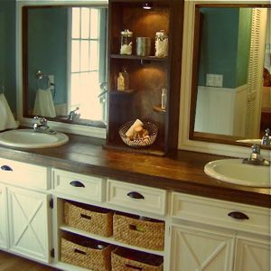 Beautiful bathroom renovation ,the symmetry makes for wonderful aesthetics, Middle shelf, baskets add warmth and great storage solution.#Bathroom