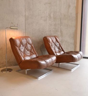 Anonymous; Steel and Leather Lounge Chairs by Tetrad, 1970s.