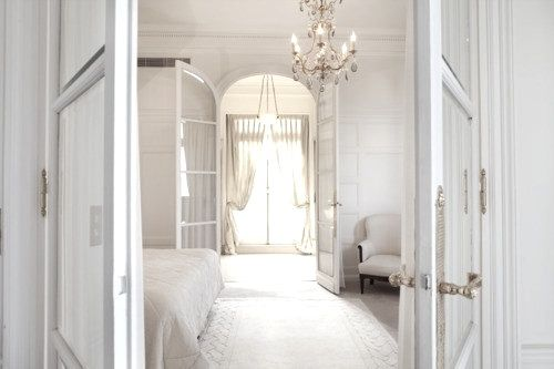 All white bedroom. Love the arched french doors