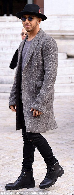 Stepping out in style: Hamilton wore a marl grey coat with a jumper, distressed jeans, lea...