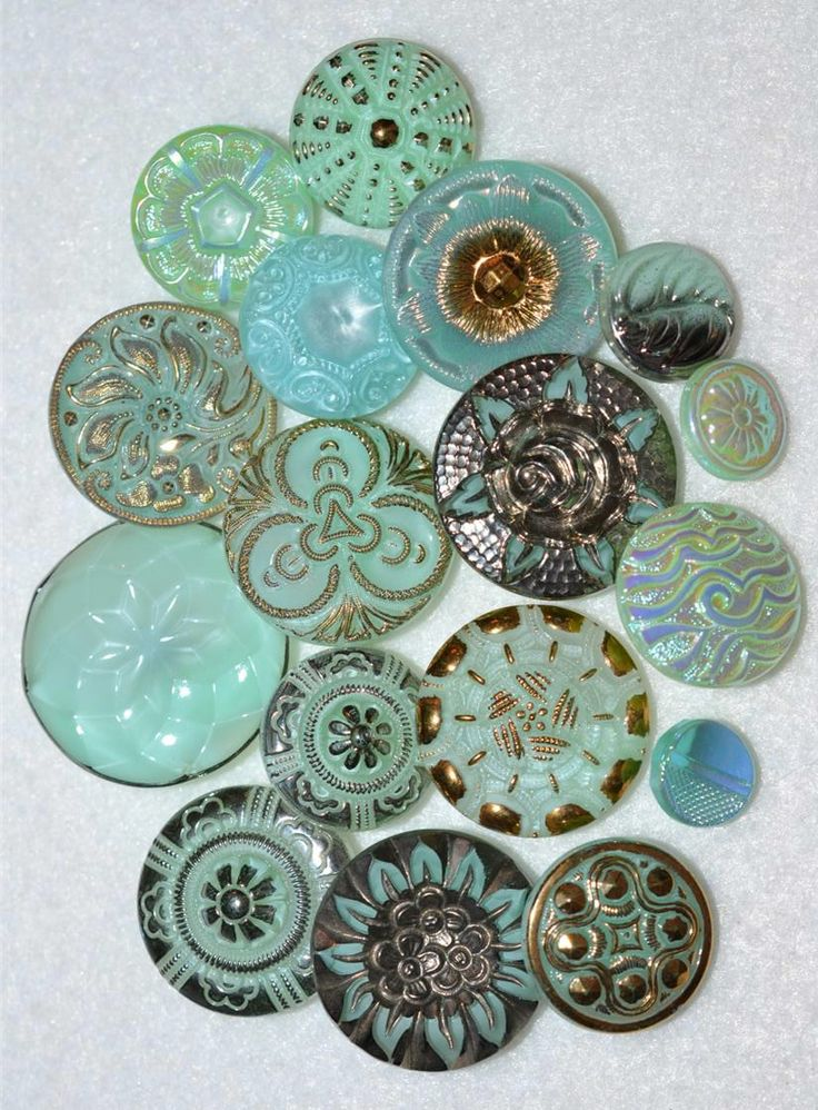Antique Czech iridescent, vaseline glass buttons in beautiful sea glass blue colours. | rePinned by CamerinRoss.com