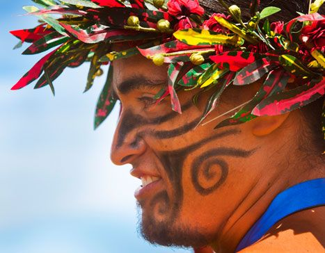 Easter Island. For the Tapati Rapa Nui, local men adopt face paint and headdresses. Photo by Eric Lafforgue