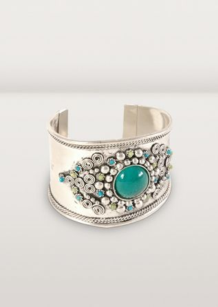 This is an accessory that pulls a whole outfit together. A spectacular cuff bracelet, it glitters with teal, green and silver, while hand-worked bead designs are complemented by spiral metal work. From Ten Thousand Villages.