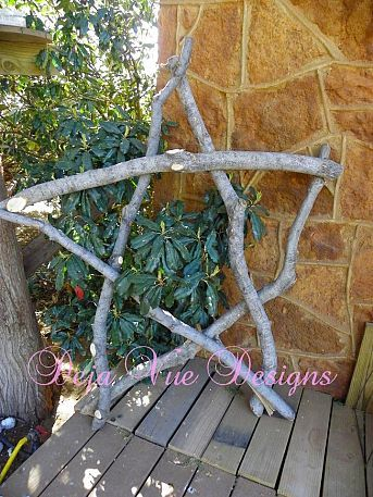 Gigantic star made from branches in the yard.