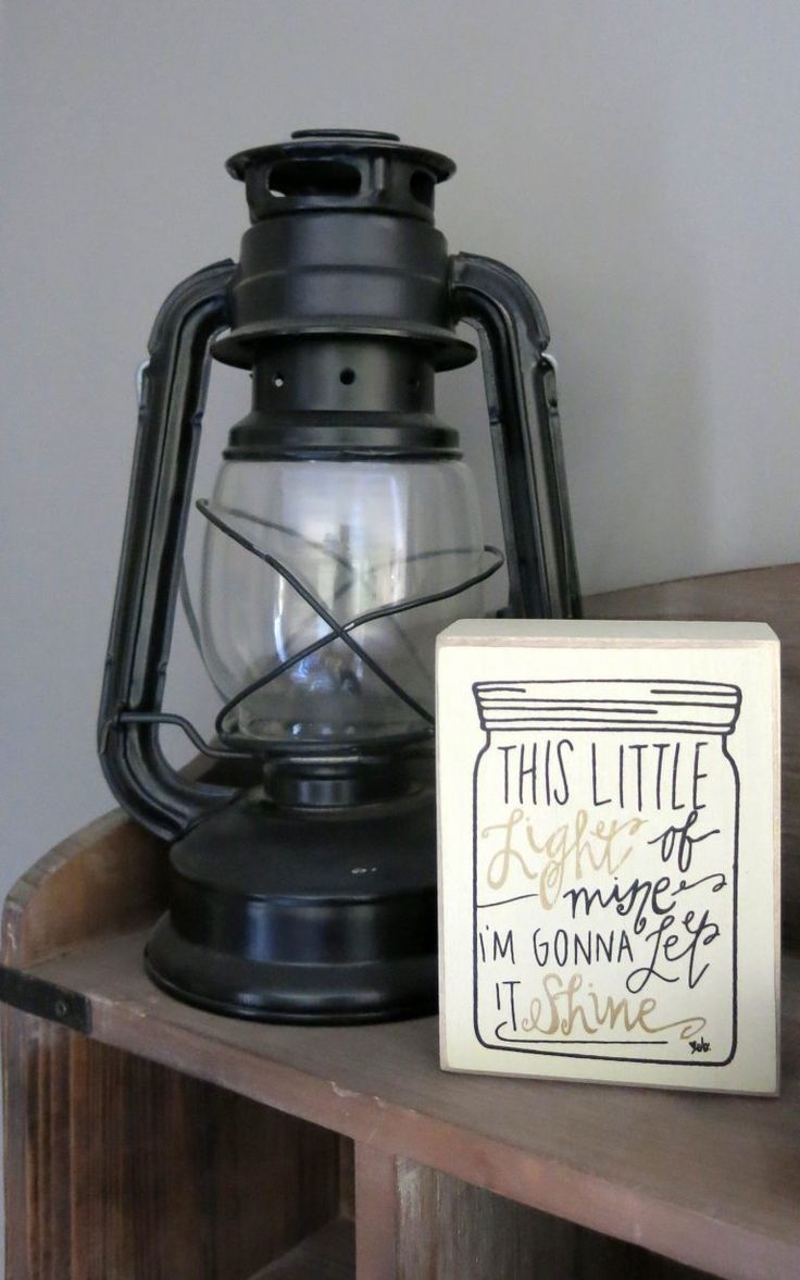 Fun camping lantern works perfect as decor in this fun rustic woodland nursery | This Little Light of Mine, I'm Gonna Let It Shine sign from Hobby Lobby