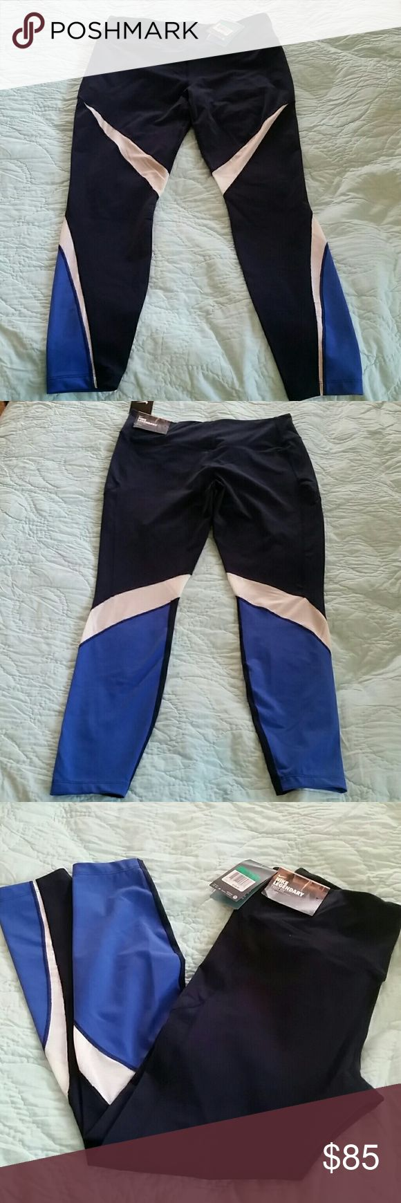 Nike DriFit Tight Fit Navy XL Training/ Run pants Navy, White and Royal Blue.  Dri Fit pants are the best thing ever.  Nylon/Spandex blend White part is mesh. Nike Pants Track Pants & Joggers