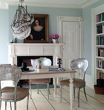 From Domino magazine. Notice how the ship chandelier adds both whimsy and airiness to the room. I first spied this ship in a layout in Elle Decor many years ago in Muriel Brandolini's living room and was surprised by how much I liked it. Also love the unexpected combination of the chairs with the farmhouse table (for a similar table check out Shabby Chic by Rachel Ashwell).