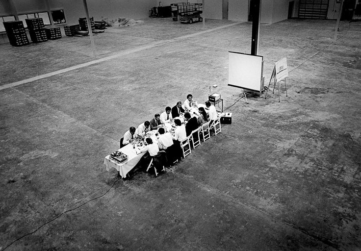 """(1986) Steve Jobs was a consummate showman who understood the power of compelling settings, like this lunch pitch on the site of the future NeXT Factory with the NeXT board of directors. Ross Perot was blown away, and invested over $20 million in NeXT after this meeting. He later said it was the worst mistake he ever made.  (Mashable, """"One photographer's unprecedented access to the Dot-Com Boom"""". Image: Doug Menuez/Contour by Getty Images)"""