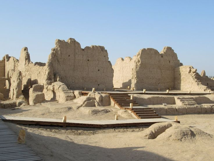 The 4th century ruins of the Grand Buddhist Temple in the ancient city of Jiaohe west of Turpan, Xinjiang, China, include a grand hall, monk's houses, courtyard, pagoda base, and courtyard walls.