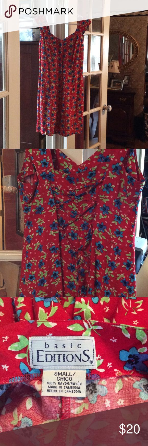Red Romper Adorable red romper with sweet blue flowers and just a hint of white and green on the leaves. Cute lace-up on the back but on top of fabric (not see through). 100% Rayon. Perfect Summer Picnic Attire! Basic Editions Dresses