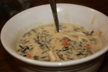 I usually double this recipe or triple it - we LOVE this soup (stew? its on the thicker side)!  You can easily freeze this to reheat later - I like to do it in my food-saver bags, then all I have to do is boil the bag.  I tend to eye-ball my measurements on the onion, carrots, celery because they just add more wonderful flavor anyways.  With the wild rice - you can either use the directions listed below or cook according to the package directions with as much rice as you want! :) Serve with…
