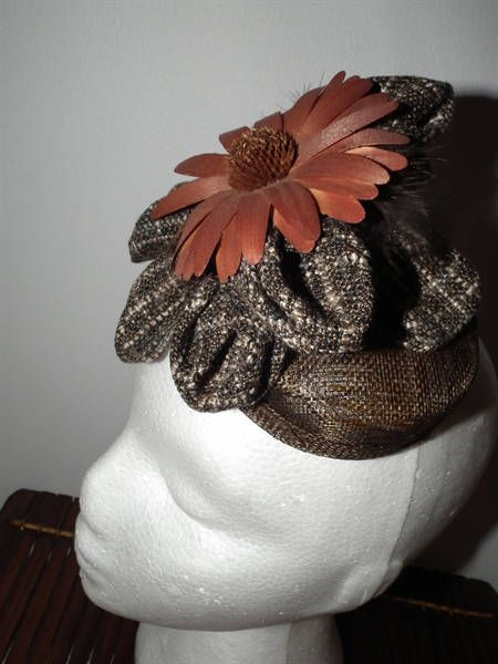 WINTER DAISY autumn fall headpiece fascinator hatinator brown tweed fabric winter material hat headpiece wedding guest mother of the bride wood daisy flower fabric manipulation races fashions trends stylish couture haute couture rust orange chocolate sinamay base Watt Milliinery Australian Fashion Designer