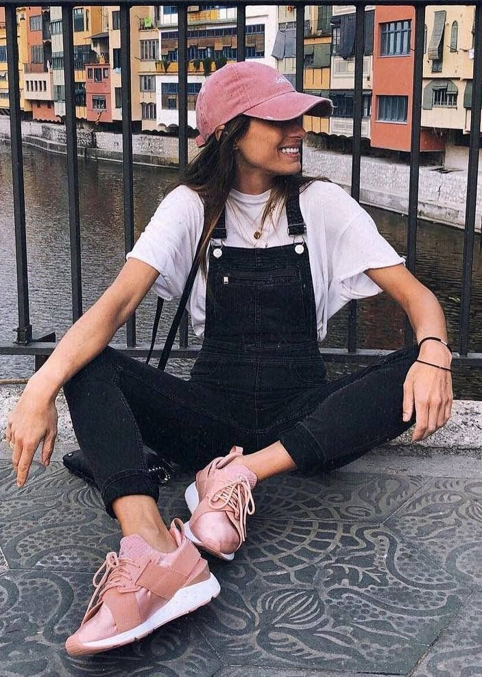 Spring Outfit Idea Pink Hat Tee Denim Jumpsuit Sneakers Street Style Street Style Chic Street Style Trends