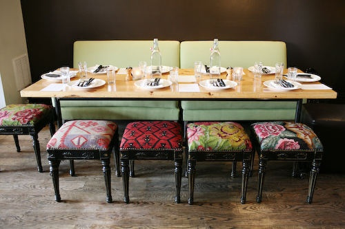 love the fabric on these benches; a less floral but similar color short sidechair slipcover might be just the thing to brighten up all the dark wood in my dining room!