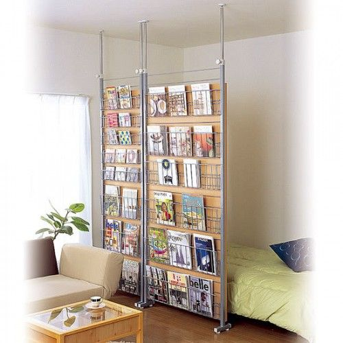 """Room divider and magazine/book storage.  This is in a bedroom, but i could see this as a method to create a """"safe"""" place for students to read."""