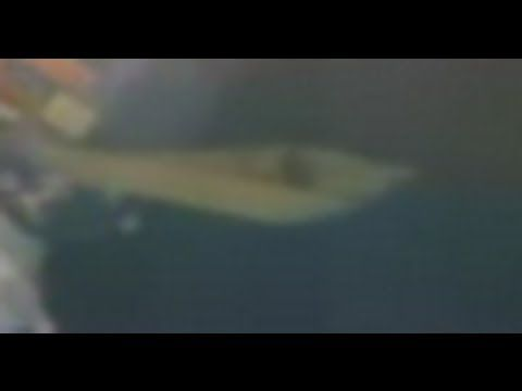 UFO docked at the ISS International Space Station.  Video feed taken from NASA