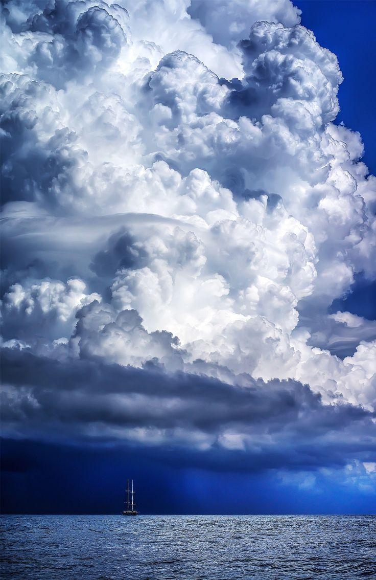 Boat under cloud, Mediterranean, Italy.