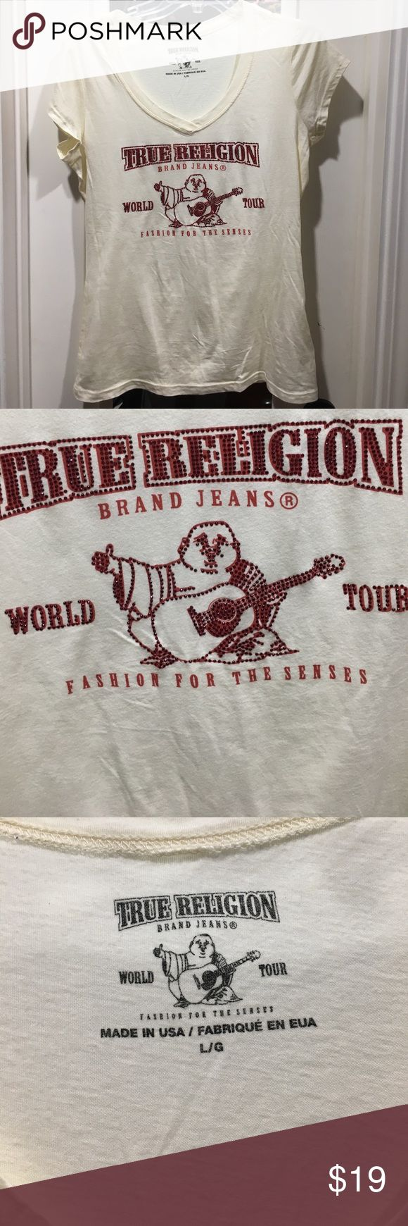 True religion T shirt for women True religion V neck t shirt for women. Cream color with red writing and studs. Couple of studs may have fallen off but not visible. May show very little signs of wear. Size L.  No damages or stains. True Religion Tops Tees - Short Sleeve