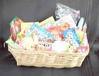 Nostalgic Candy Gift Basket - 50's  Party Favors. This basket is filled with 50's candies. Sixlets, boston baked beans, lemon heads, kits, mini razzles , fly saucer candy, bubble cigar, b b bats. You get 50 pieces of candy which makes it a perfect for sharing.  Planning a 50's party this will make a great centerpiece.