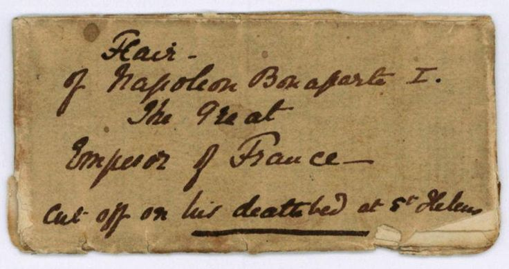 """Napoléon I, Emperor of the French (1769-1821).  A single hair, cut off on his deathbed - Napoléon I, Emperor of the French (1769 - 1821. [1023418]  [St. Helena, 5. V. 1821]. - Single hair in folded package. """"Hair   of Napoleon Bonaparte I.   The Great   Emperor of France   Cut off on his deathbed"""" - """"Napoleon's Hair given Lord Queensberry by Dr Arnot [sic] who attended him on his death Bed"""