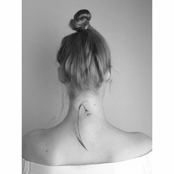Hand poked snowdrop tattoo on the back of the neck.