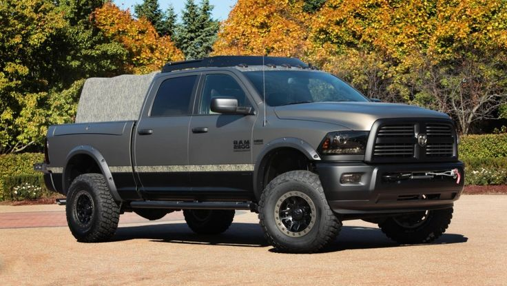 Mopar's 2015 RAM 2500 Outdoorsman Mossy Oak Edition Concept with a 6.4L HEMI V8, Warn 12,000lbs. Winch, Mossy Oak theme exterior, Green Vinyl interior, 35in BFGoodrich Mud-Terrain T/A KM2, Rambox, Bench from the Sunrider truck from 2013 SEMA, and a new top that fits between the rails on each side of the Ramboxes.