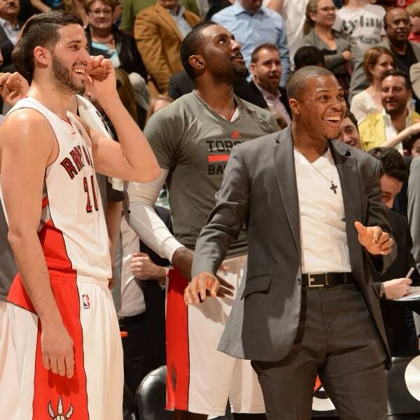 Kyle Lowry cheering his team, Toronto Raptors, on from the sidelines.