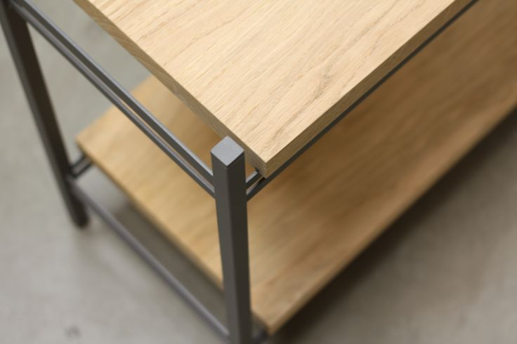 ADD ON Shelving system. Designed by Venessa Eilert. Elegant storage with shelves in solid oak and a grey metal frame.